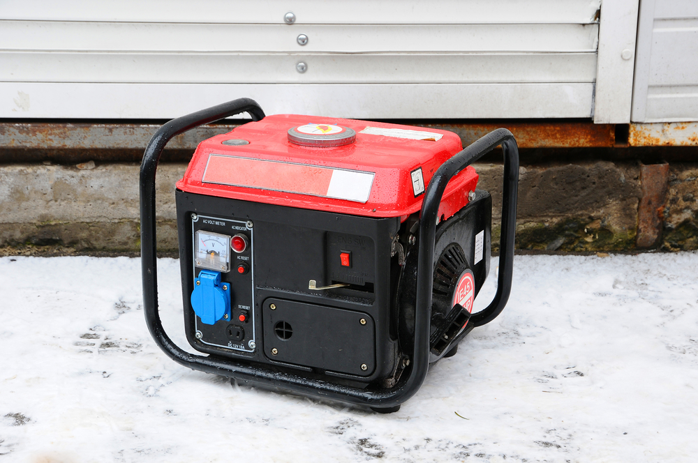 small red generator on snow